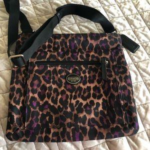 Coach cross body water proof leopard print purse